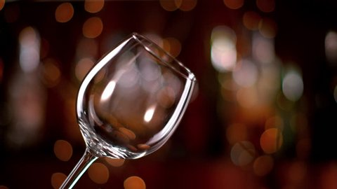 Super slow motion of pouring red wine into glass. Filmed on high speed cinema camera, 1000 fps.