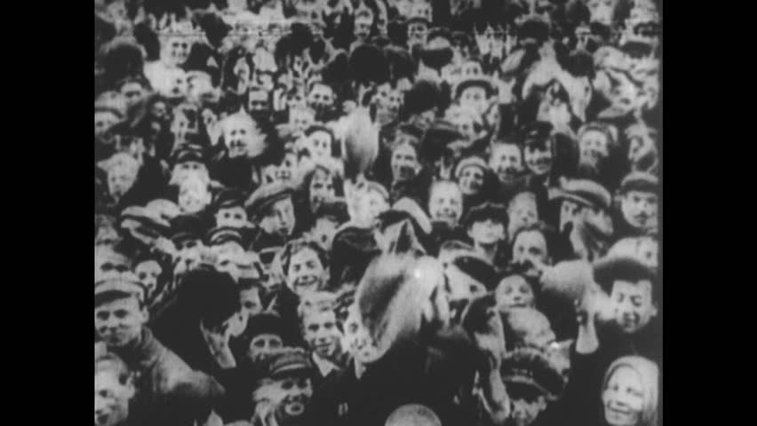 RUSSIA 1910s: Crowd cheers / Leon Trotsky waves / Pan of crowd / Vladimir Lenin speaks / Photo of Lenin with Joseph Stalin / Stalin seated.