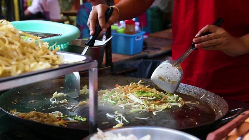 Pad Thai cooking. street food on  food market in Bangkok Thailand    Shutterstock HD Video #1022637517