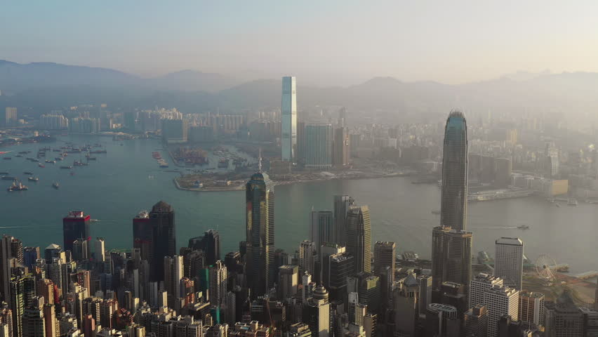 Fly over Urban city scene around Victoria peak and Victoria Harbour with Day light, Hong Kong Transportation, 4k high resolution video | Shutterstock HD Video #1022637757