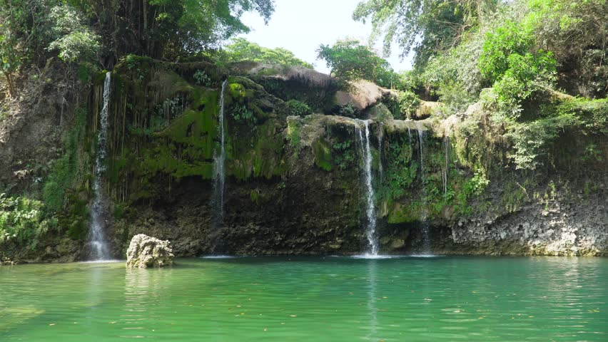 Waterfall in green rainforest. Bolinao waterfall in the mountain jungle. Philippines, Luzon. Travel concept. | Shutterstock HD Video #1022654197