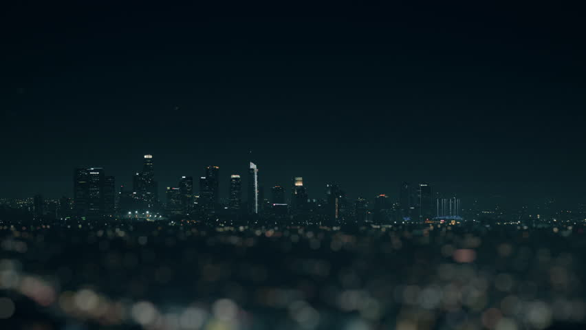 Los Angeles Downtown Low Angle with Foreground Blur. a night view of downtown Los Angeles with a shallow depth of field and focus on the buildings   Shutterstock HD Video #1022698477