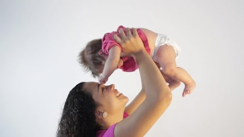 Pretty woman holding a newborn baby in her arms.