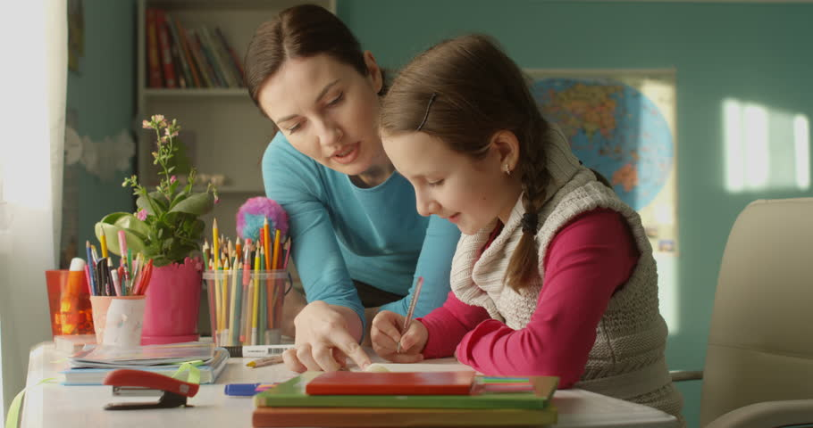 Attractive Parent Mother Helping to Do Homework to Little Student School Girl | Shutterstock HD Video #1022760487