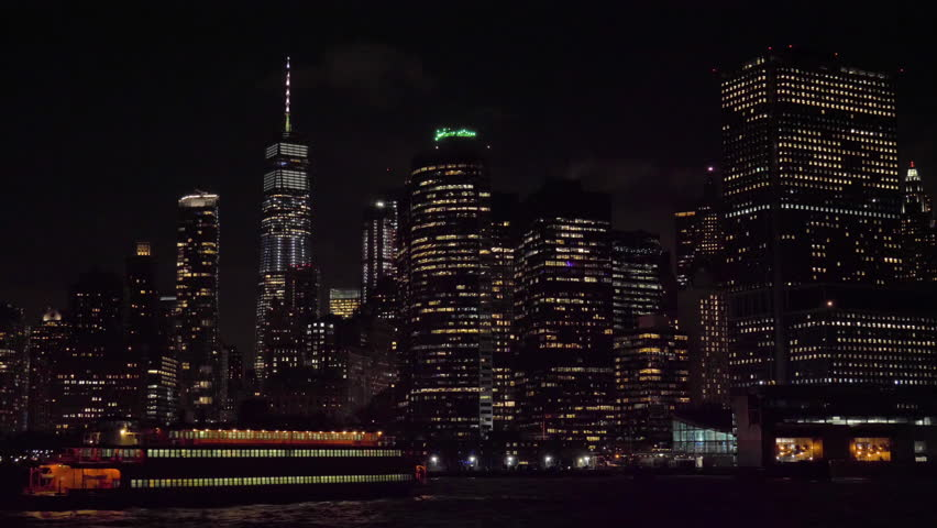 Manhattan Urban Skyline at Night and Ship. New York City. View From the Water. Camera Tilts Up | Shutterstock HD Video #1022763337