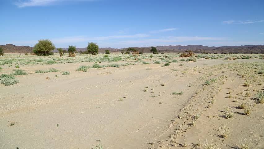 In the middle of the desert rock and track like concept of wild and nature scenic land   | Shutterstock HD Video #1022804857