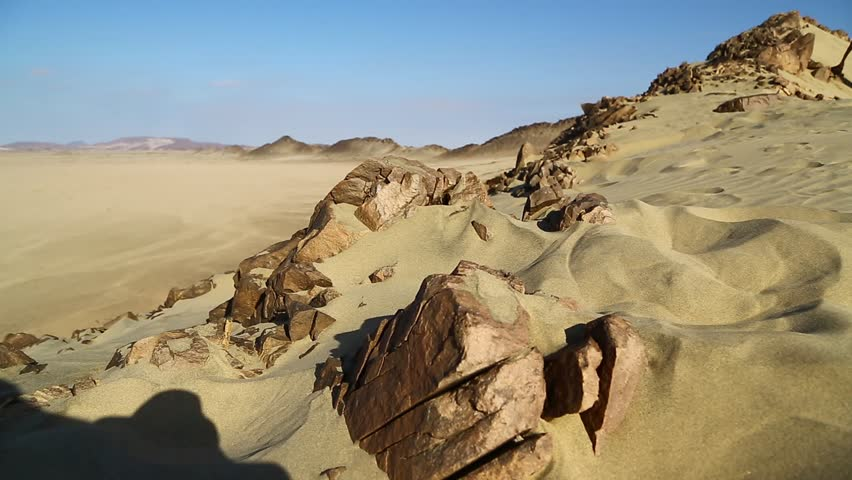 In the middle of the desert rock and track like concept of wild and nature scenic land   | Shutterstock HD Video #1022804947