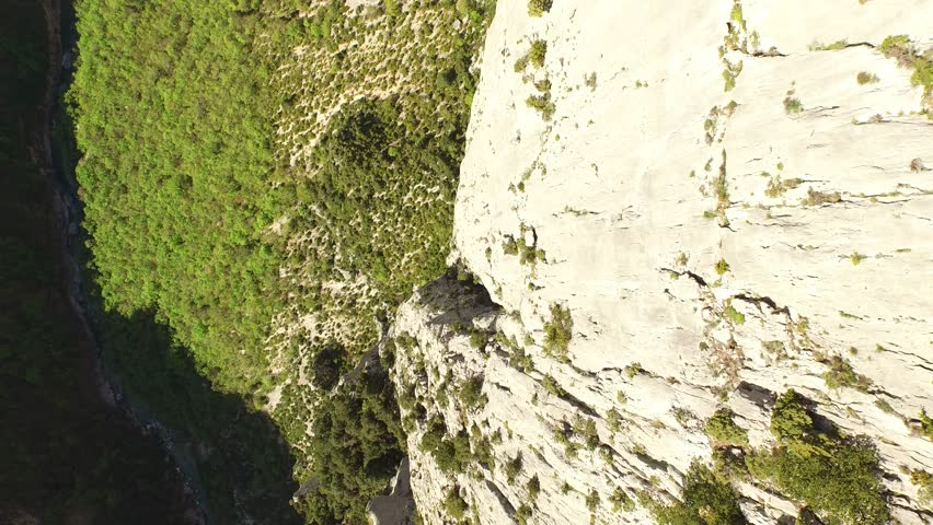 Aerial view by drone of a man climbing in free solo, without safety material, a very high cliff in Verdon, France | Shutterstock HD Video #1022819527