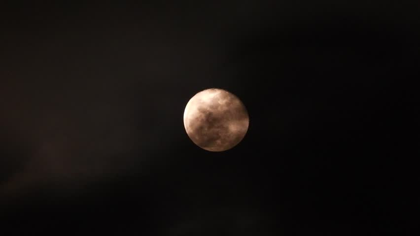 Extreme zoom photo of moon at night with deep dark clouds and strong wind | Shutterstock HD Video #1022837557