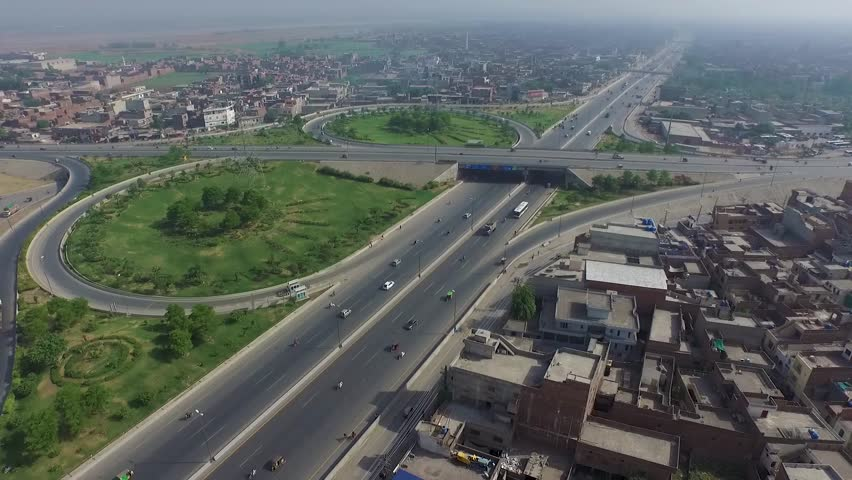 Aerial view of cars and buses commuting along a section of Highway in Lahore, Pakistan | Shutterstock HD Video #1022842237