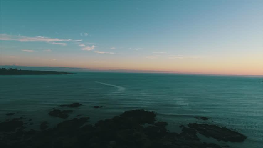 Twilight Aerial Ocean View Sunset at Hicks Bay, New Zealand. | Shutterstock HD Video #1022846647