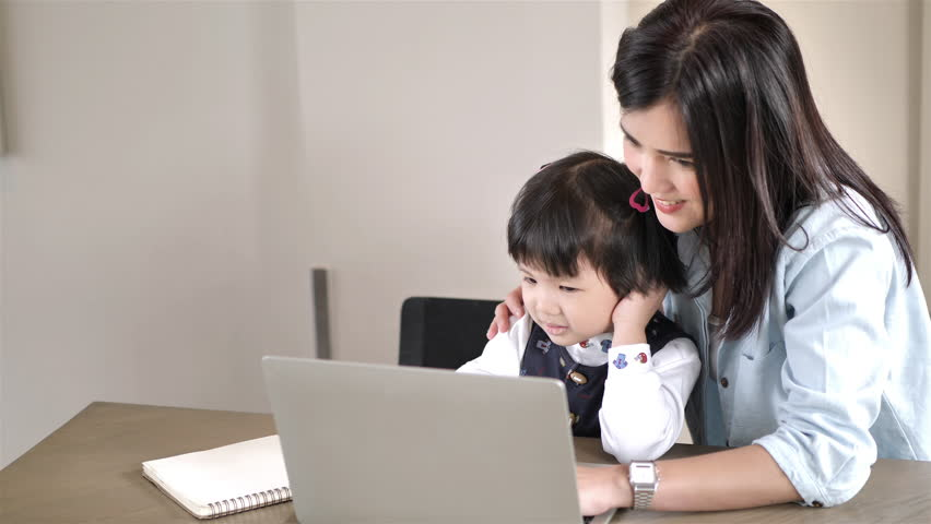 Asian Mother and daughter 5 years old using  laptop computer together at home. Education and Technology concept Slow Motion | Shutterstock HD Video #1022861947