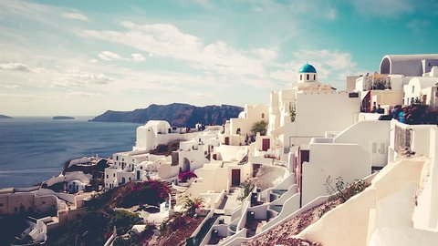 Picturesque cliffside town of Oia on the mediterranean island of  Santorini, Greece, timelapse