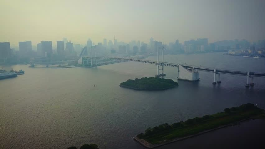 Aerial view of rainbow bridge at day time over water pan right   Shutterstock HD Video #1022912827