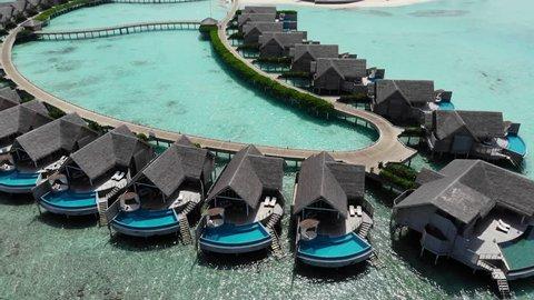 Aerial view of  luxury 5 star resort hotel water bungalow on Maldives white sandy beach