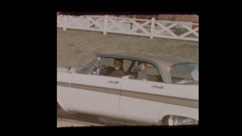 Little boy shoots cap gun from vintage car 1957 Plymouth Belvedere