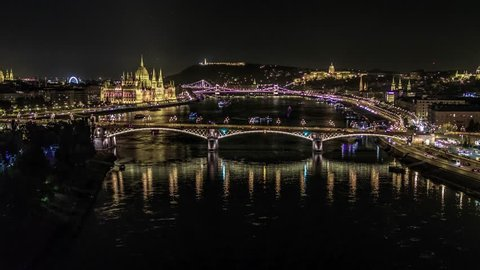 Establishing Aerial View of Budapest, River Danube and Bridges at night, Hungary