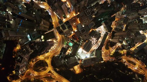 Bird eyes view of Hong Kong cityscape from the drone at night time. 90 degrees aerial view from drone of Hong Kong city. Drone is Flying Forward.