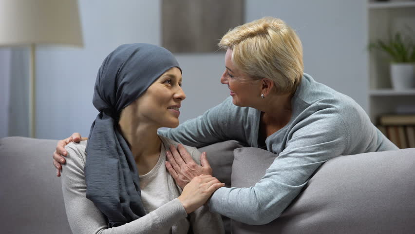 Mother hugging and kissing her hopeless daughter with cancer, family support | Shutterstock HD Video #1023106837
