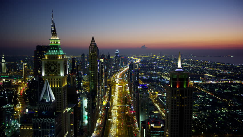 Aerial night illuminated city view Sheikh Zayed road commercial condominium district vehicle transport highway metro rail UAE Middle East Dubai RED WEAPON | Shutterstock HD Video #1023220267