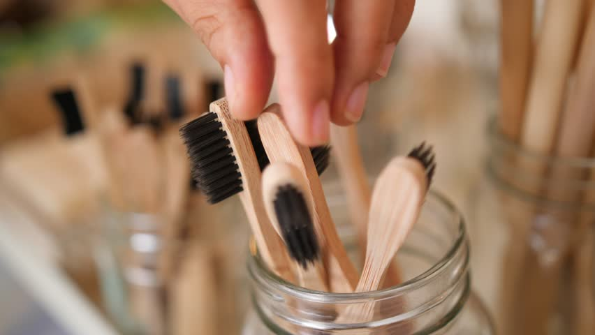 Young Mixed Race Woman Choosing Bamboo Eco Friendly Biodegradable Toothbrush in Zero Waste Shop. No plastic Conscious Minimalism Vegan Lifestyle. Reduce Reuse Recycle 4K Slowmotion Concept. | Shutterstock HD Video #1023292177