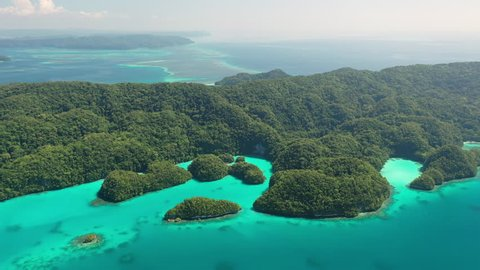 Aerial view of Rock Islands (Chelbacheb), Ngeruktabel island, seascape with colorful coral reefs and lagoons - landscape panorama of Micronesia from above, Palau