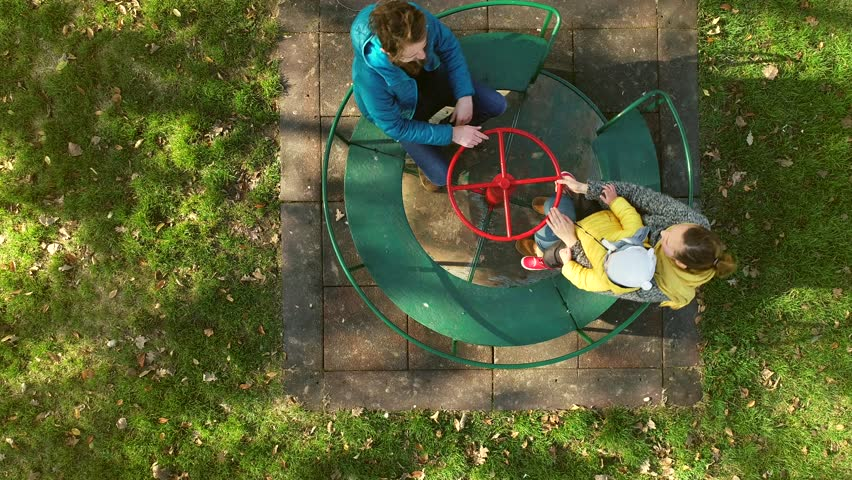 Aerial view of family enjoying day at the public playground, Zagreb, Croatia. | Shutterstock HD Video #1023385567