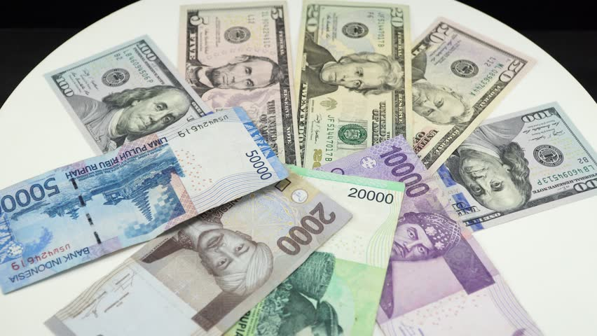 Indonesia Money And Us Dollar On White Background 4k