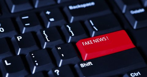 Human finger pressing Fake News button on the computer keyboard. Shot in 4k resolution