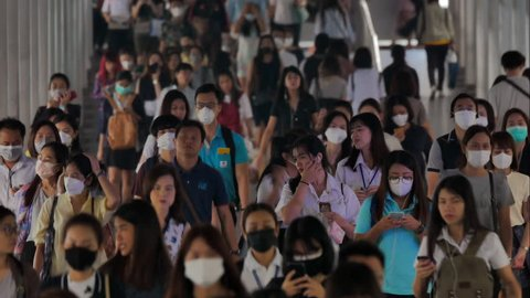BANGKOK THAILAND, 30 Jan 2019, Time lapse of many people wearing face mask for protect micro dust in air while going to their workplace during pm2.5 air pollution crisis in Bangkok at moring rush hour