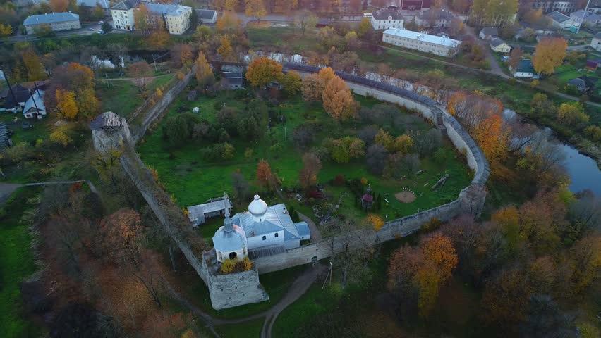 Porkhovskaya fortress cloudy October evening (aerial video). Porkhov, Russia