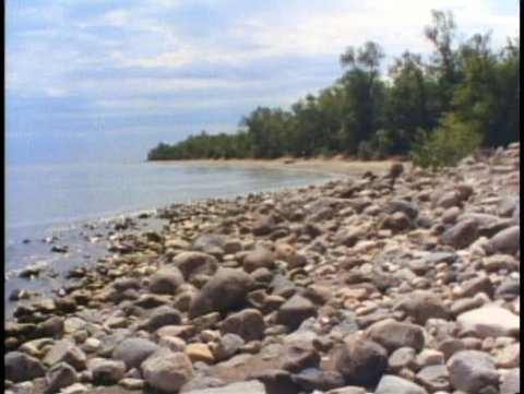 WINNIPEG, MANITOBA, 1990, Winnipeg Beach, rocks on lake shore, wide shot