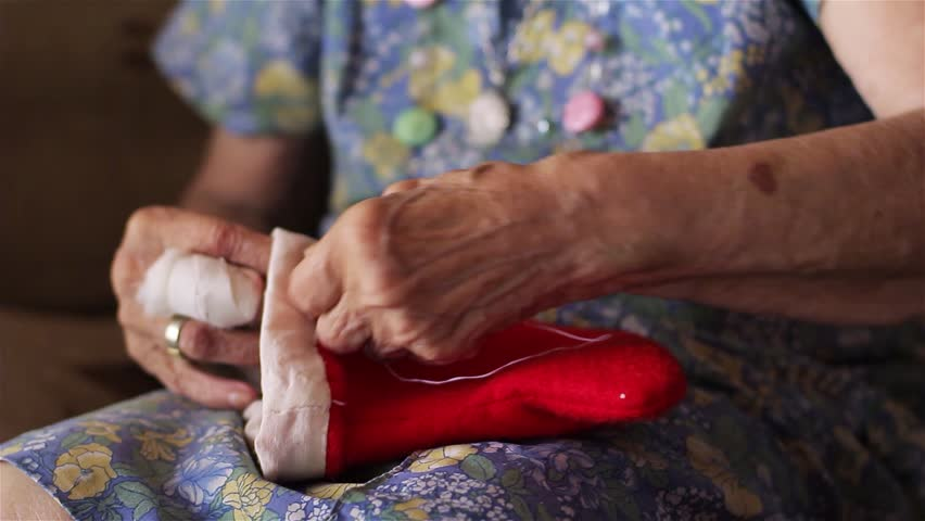 Senior Woman Sewing Phrygian Cap. | Shutterstock HD Video #1023550627