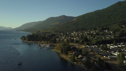 Aerial view of a small town on the Pacific Ocean during a sunny summer sunset. Taken in Port Alice, Northern Vancouver Island, BC, Canada.