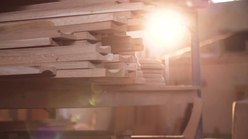 Beautiful Frame of Wood for Furniture at Large Manufacturing Factory. Sun Rays illuminated numerous Oak Wood Products on the Background. Carpentry. Handicrafts. Woods Productions. | Shutterstock HD Video #1023643327