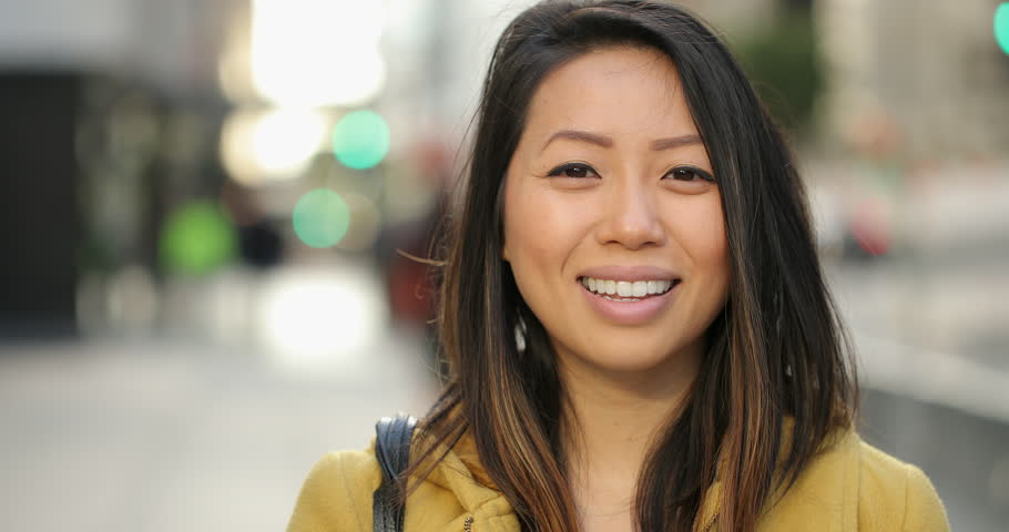 Young Asian woman in city smile happy face portrait #1023647947