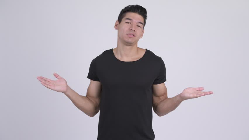 Young confused multi-ethnic man shrugging shoulders | Shutterstock HD Video #1023660607