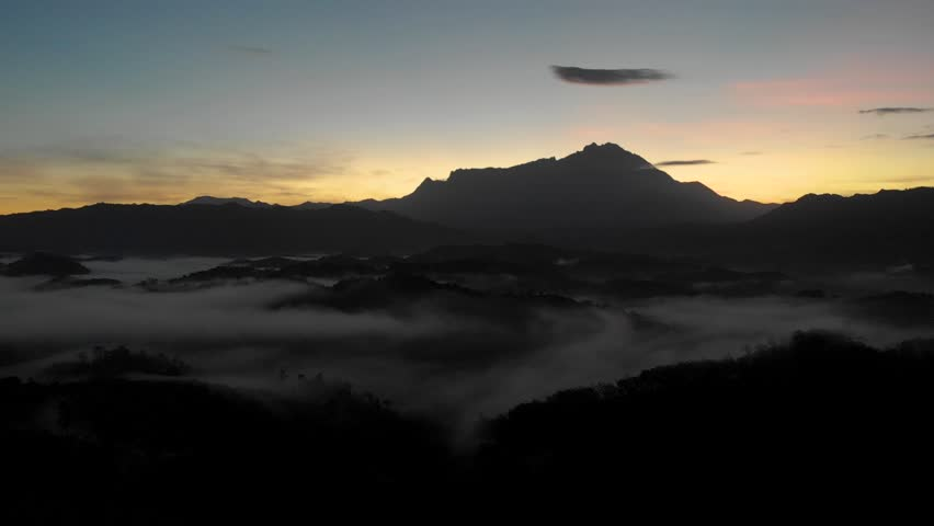 Nature aerial footage of beautiful sunrise with misty foggy and Mount Kinabalu at Sabah, Borneo, Footage take during low light | Shutterstock HD Video #1023741067
