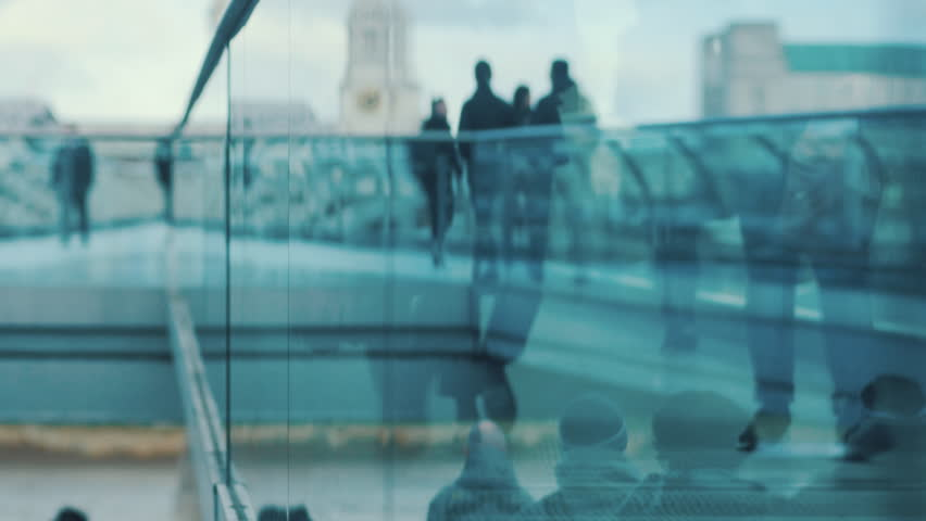 People walking through glass reflection. Business people going to offices and tourists. Brexit, leaving Europe. 4k Video different colors and style in the gallery | Shutterstock HD Video #1023799837