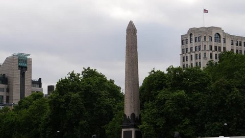 LONDON / ENGLAND June 23 2017: The obelisk named Cleopatra's Needle in City of Westminster, London, England. Seen from a boat ride on River Thames.