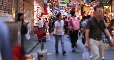 Hong Kong, China 4 SEP 2018: Hong Kong street market urban scene. People walk and buy produce from local shops in Wan Chai district