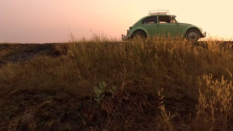 CHAIYAPHUM, THAILAND - FEBRUARY 10: 4K video classic volkswagen beetle car at sunset time on the february 10, 2019 in Chaiyaphum Thailand