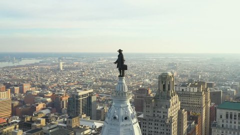 Aerial flyover William Penn Statue on top of the Philadelphia City Hall tower