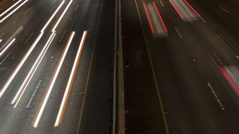 Time lapse close up night motion light trails on a busy Los Angeles freeway
