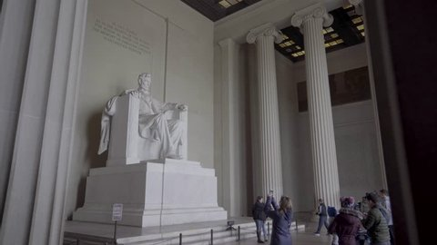 Washington, D.C., USA, February 3, 2019:   Statue of President Abraham Lincoln as Visitors Take Photos - The famous statue of President Abraham Lincoln sits inside the Lincoln Memorial as tourists and