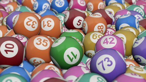 coloured lotto balls rolling, two versions: the first with light background and the second with black background (3d render)
