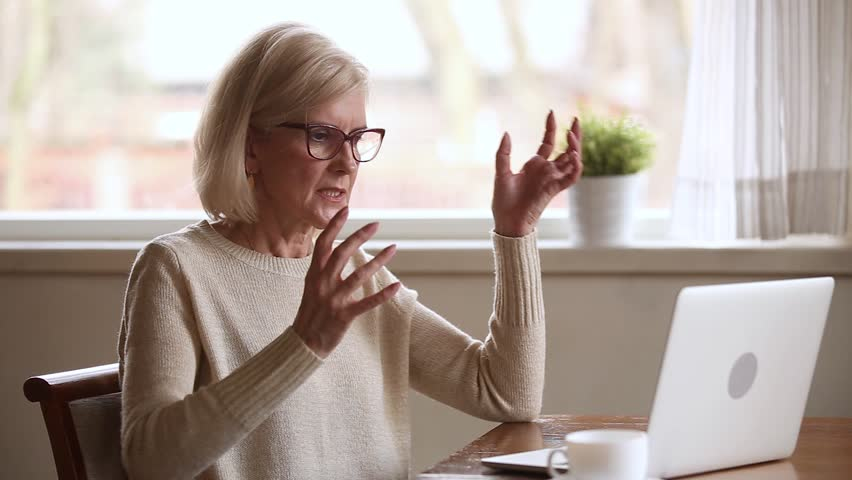 Stressed senior middle aged businesswoman annoyed using stuck laptop, angry mature old lady mad about computer problem frustrated with data loss, online mistake, software error or system failure