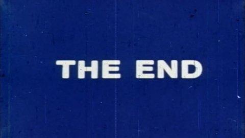 The End - damaged vintage film ending title, white letters, blue screen