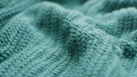 The texture of the fabric. Green knitted texture. Close-up. Can be used as a background. HD