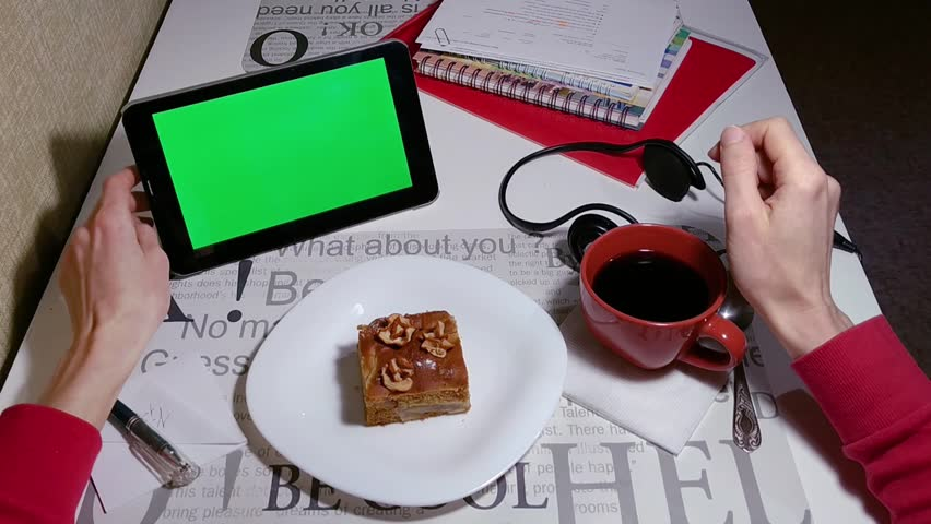 Woman works on tablet green screen in cafe with coffee and cake on a table | Shutterstock HD Video #1024257047